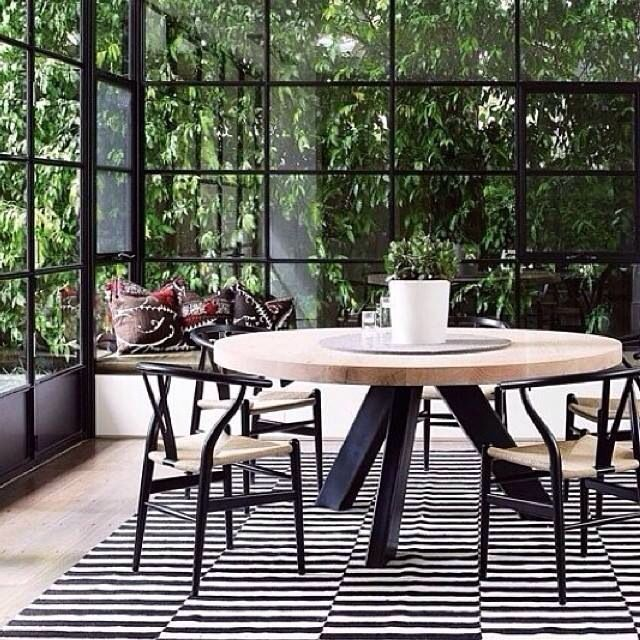 Mark Tuckey table. Also love the chairs for dining table. Like the windows. Love the black with wood. quite like a round dining table. Not sure if this would work?!