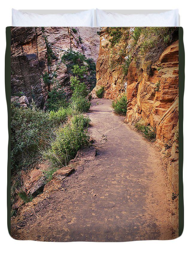 Evgeniya Lystsova Duvet Cover featuring the photograph Mountain Road Along Cliffs by Evgeniya Lystsova. Mountain road along the sandstone cliffs at Zion National Park, Utah. Make your Home special with stylish art products you choose! Our soft microfiber duvet covers are hand sewn and include a hidden zipper for easy washing and assembly. Your selected image is printed on the top surface with a soft white surface underneath. #Landscape #Zion #Mountains #DuvetCover #HomeDecor #Bedroom