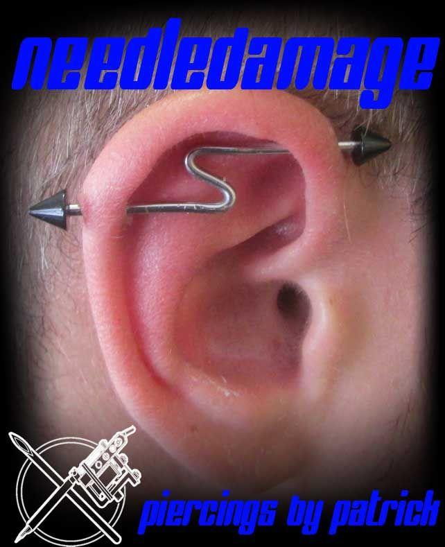 Healed industrial piercing with custom lightning bolt bar