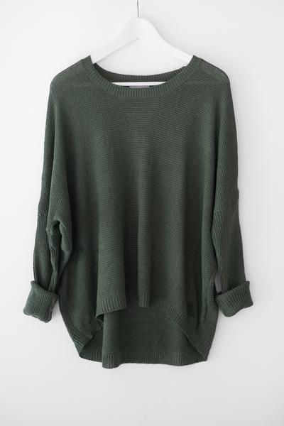 - Lightweight knit sweater - Oversized fit with dropped shoulder - Round neckline - Asymmetrical hem - Fitted ribbed sleeves - Available in Hunter Green or Camel - 55% Cotton 45% Acrylic - Imported