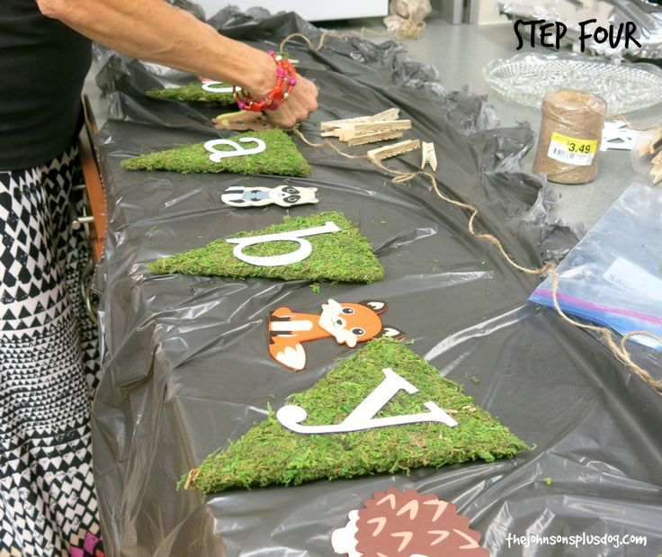 Easy moss covered banner for rustic woodland baby shower