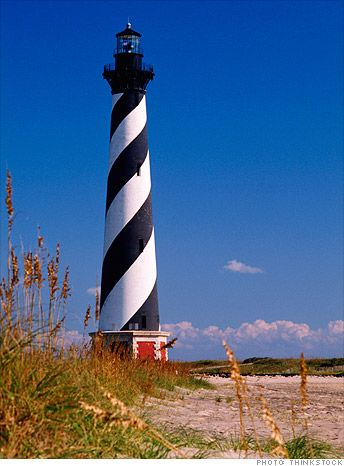 """""""For newlyweds on the East coast, North Carolina's Outer Banks is a quick (and cheap) flight with beautiful beaches and plenty of outdoor activities like windsurfing and horseback riding."""""""