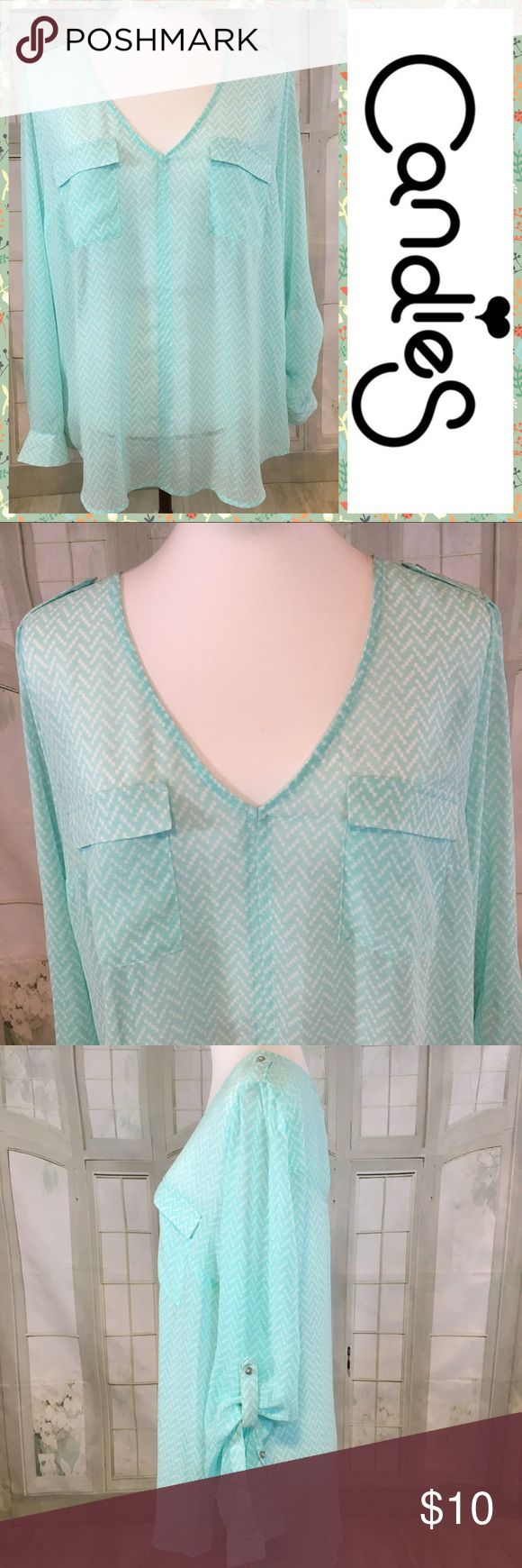 "Candies Sheet Tunic V Neck SZ XL Candies Sheet Tunic V Neck SZ XL. Light Turquoise Color with White Dotted pattern. Sheer V Neck with double front pockets (real) Flowing Tunic.  Perfect as Swim cover or Top with tank underneath (or not). Sleeves can be worn 3/4 buttoned or long. Excellent condition - no flaws. 100% Polyester.   Pit to Pit:  23"". Length:  28"". Candie's Swim Coverups"