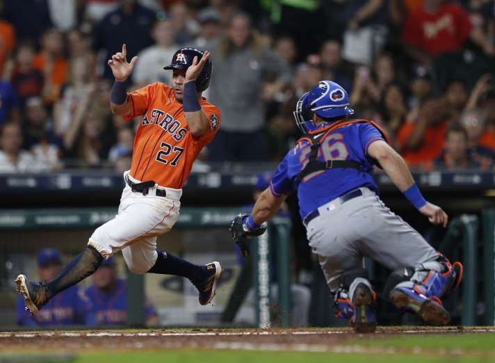 Houston Astros Jose Altuve (27) runs around New York Mets catcher Kevin Plawecki (26) to score a run on Marwin Gonzalez's single in the sixth inning of game two of a doubleheader of an MLB baseball game at Minute Maid Park, Saturday, Sept. 2, 2017, in Houston. ( Karen Warren / Houston Chronicle )