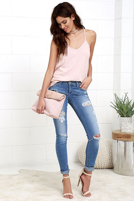 The answer to all your styling problems has been answered! The Obey Thea Blush Pink Tank Top is perfect for pairing with ... well, just about everything! Soft and stretchy cotton shapes this skin-baring tank top with a V-neckline and plunging V-back with sliding, strappy detail. Logo tag on front hem.