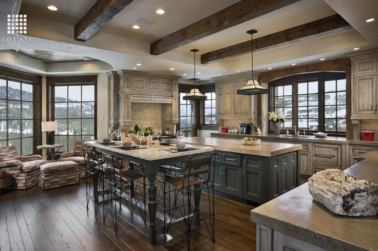 Eclectic Kitchen with Flush, Kitchen island, Pendant Light, Simple granite counters, Wood counters, Flat panel cabinets