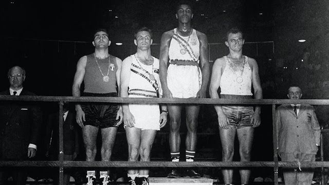 Cassius Clay, second from right, on the medal stand after winning gold in the light-heavyweight division at the 1960 Summer Olympics in Rome.