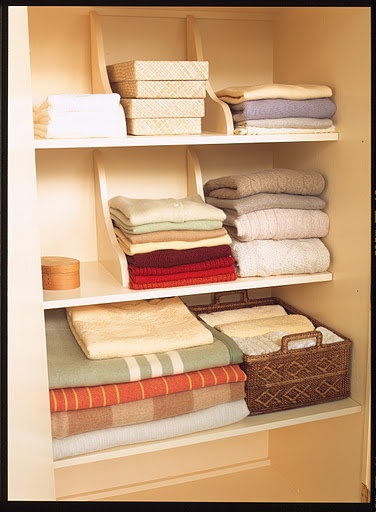 DIY Linen Closet Using Wall Brackets, organization at its finest!