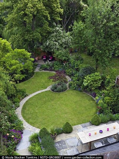 Circular lawn with paved path to access the far end of the garden and take you on a journey