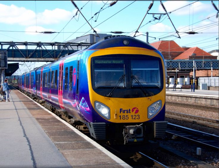 First TransPennine Express (First group): a Siemens Desiro Class 185 DMU departs from the station with a train Manchester Airport