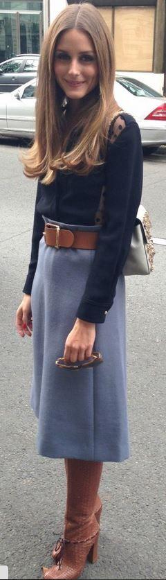 Who made  Olivia Palermo's blue skirt, black dot shirt, tan handbag, and brown knee high boots?