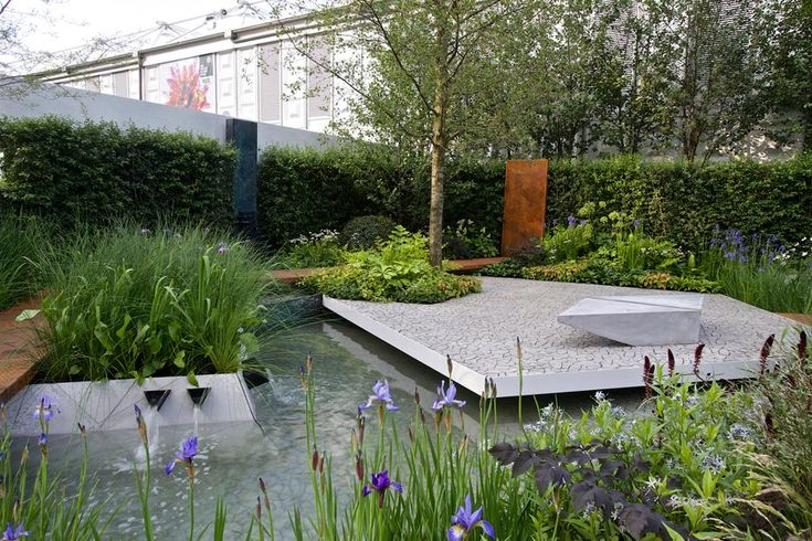 RHS Chelsea Winner - Paradise Garden by M&G. The raised platform over the water adds depth and would make a great seating area!