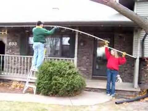 """Demonstration of the Crevier Christmas Light System, where lights are attached to custom-cut 1/2"""" PVC pipes with plastic zip ties. The pipes are then clipped onto the house with standard broomstick clips. Full project details are available on the web:    http://www.teamdandy.com/projects/christmaslights/    by Scott & Randy Crevier"""