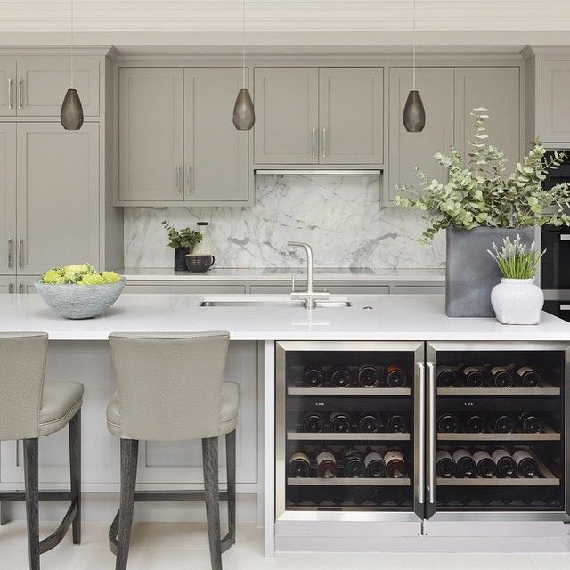 Rustic chic kitchen from our Cobham project. Love these lights we imported from the U.S. and of course the marble splashback which adds a layer of luxury and pattern #kitchen #kitchendesign #mansion #marble #lighting #barstool #rusticinteriors #luxuryinteriors #luxuryhome #gorgeoushome #houzz #sophiepatersoninteriors #hgtv
