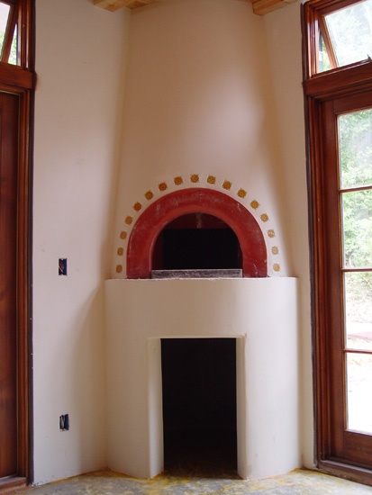 Indoor wood fired oven, smartly tucked in a corner of the kitchen.