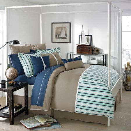 Nautically striped comforter set in green, blue, and khaki.  Product: Comforter, bed skirt, and 2 striped shamsConstructi...