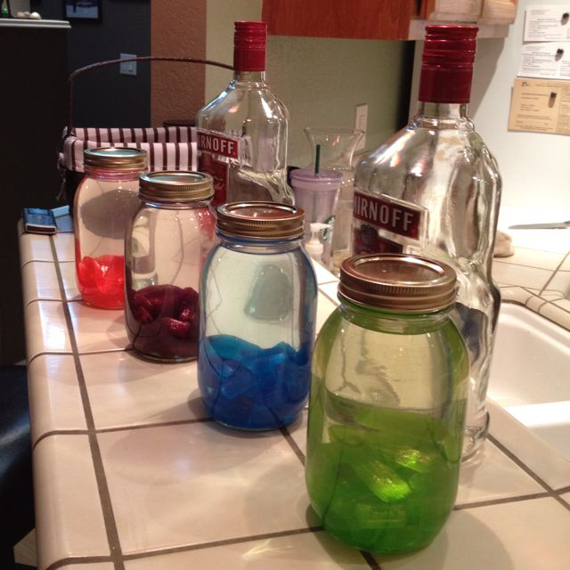 Jolly rancher vodka.... So easy! 35 Jolly ranchers of one flavor in a quart jar. Add 3 cups of vodka to fill. Leave for 24 hours and shake as much as you can. Tastes great with Sprite too! Makes a great gift :)