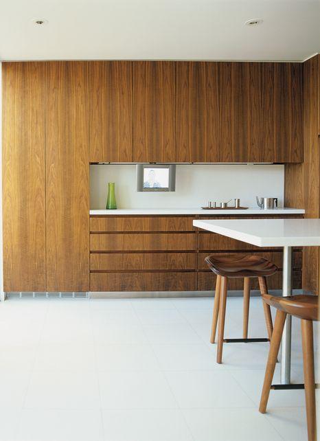 walnut veneer cabinetry + white terrazzo