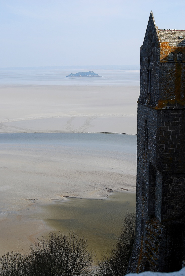 view of the quicksand and small islands that surround Mont St. Michel.