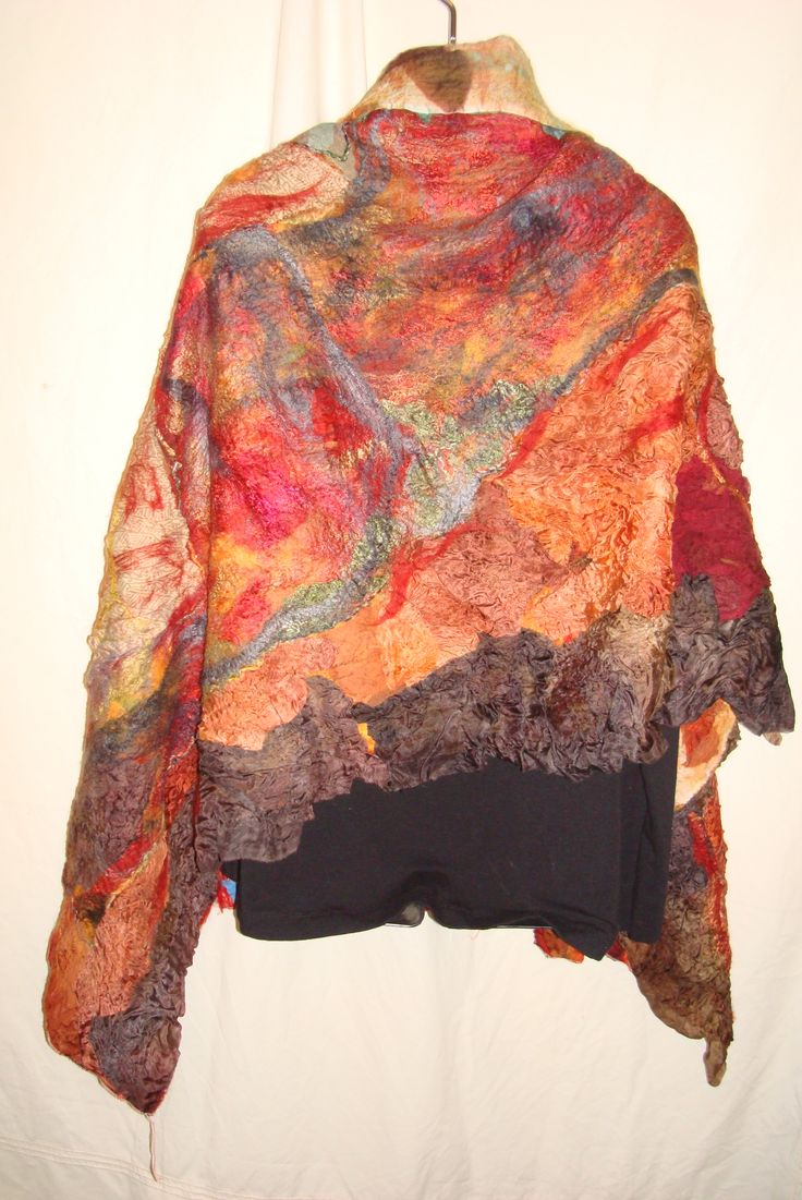 Our Land abounds in nature's gifts Reversible nuno mosaic collage felted vest. Australian Merino wool embellished with numerous grades of silk fabrics and fibres. this vest has many styling possibilities. AUD $ 375 sold  Created by Barbara Scott www.facebook.com/wowcreationsqld
