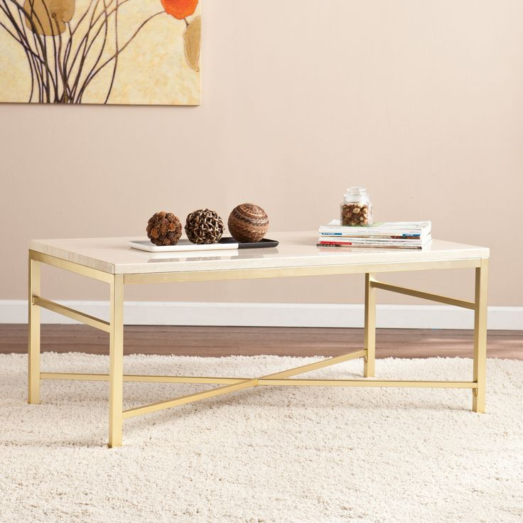 Transform your living room into a sophisticated focal point by adding this stone-style cocktail table. Open frame in soft, matte brass complements the polished travertine surface for a glamorously ele                                                                                                                                                                                 More