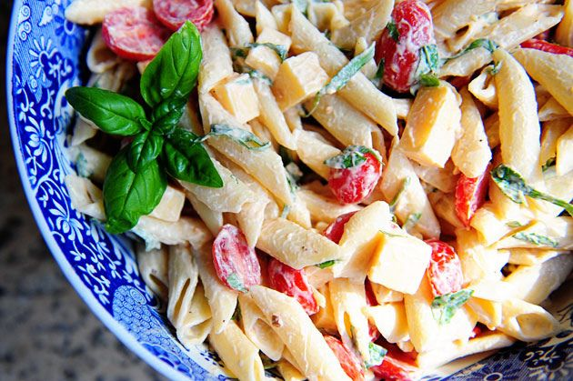 MY FAVORITE summer salad recipe!  Warmer weather makes me crave it!  Spicy Pasta Salad with Smoked Gouda, Tomatoes and Basil