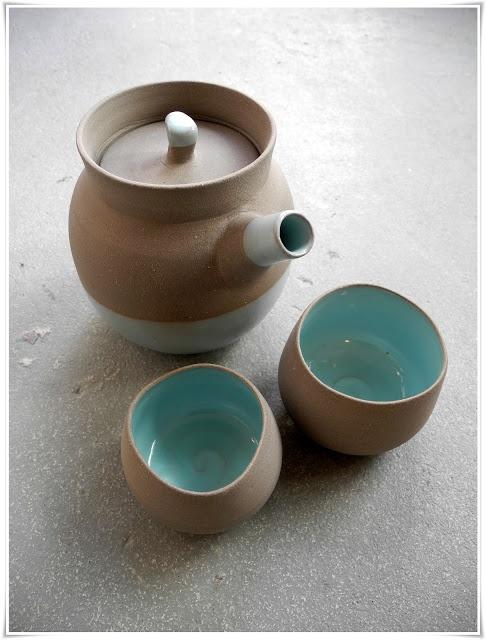 Handthrown stoneware teapot in mint green and grey matt unglazed.