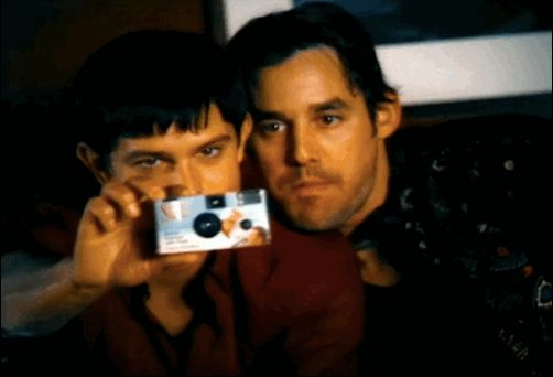 And Xander and Roswell's Max Evans (aka Jason Behr) have an epic disposable-camera selfie fail. | This Promo For The WB From 2000 Will Blow Your Mind