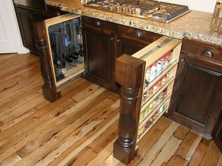 Lewis Custom Woodwork - Kitchen - posts pull out to reveal secret storage - spice rack