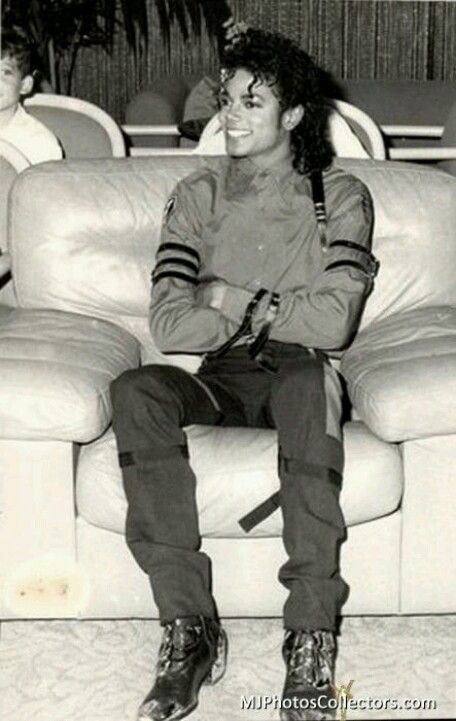 you never really see Michael doing normal things like sitting on a couch... here he is though! :)