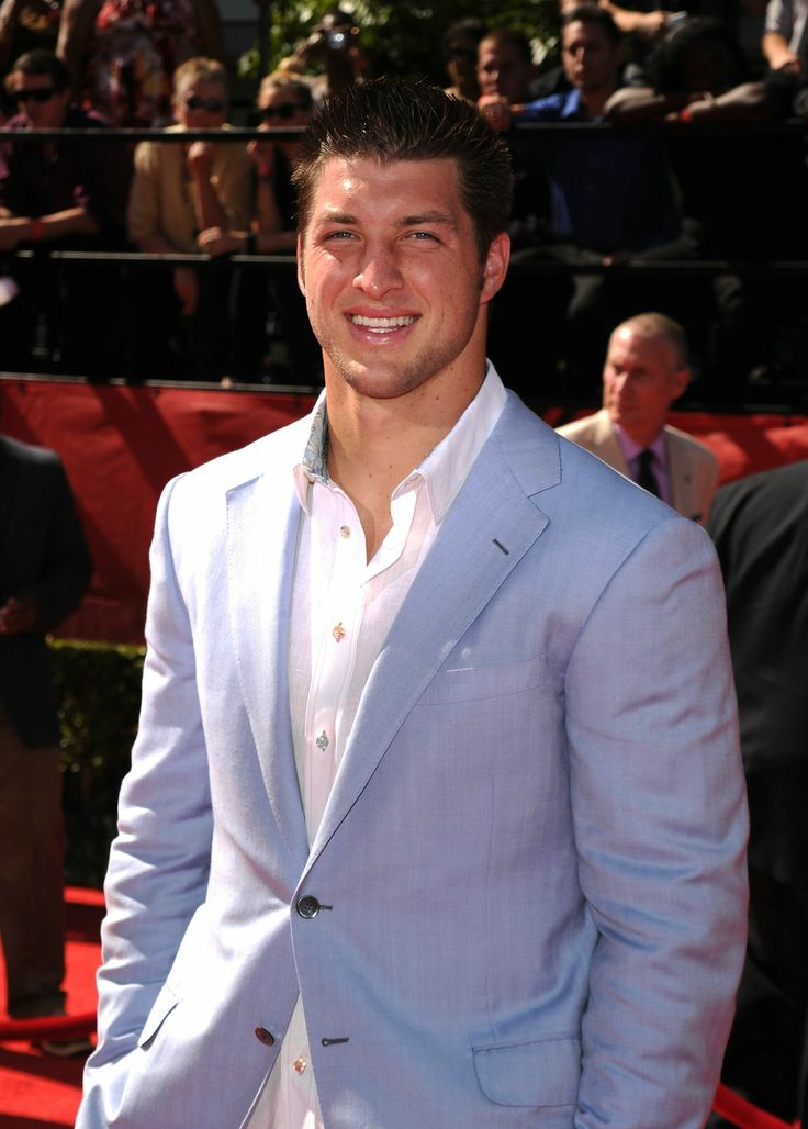 "Tim Tebow: As weird as it may seem, my brother looks exactly like this guy. He has even sat in bars and signed autographs as him. Whenever girls say ""Tim Tebow is so hot"" it really gives me the shivers. My brother is not allowed to be hot, he my big brother!"