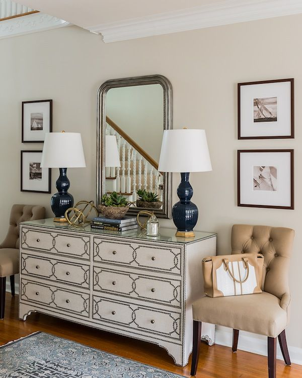 Love the dresser in the entryway, as well as the navu lamps and sailing pictures.