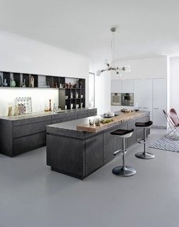 "Concrete – New ideas for Kitchens.In a minimalist setting, ""concrete"" always presents a strong presences in the room. In the handle-less CONCRETE-A kitchens"