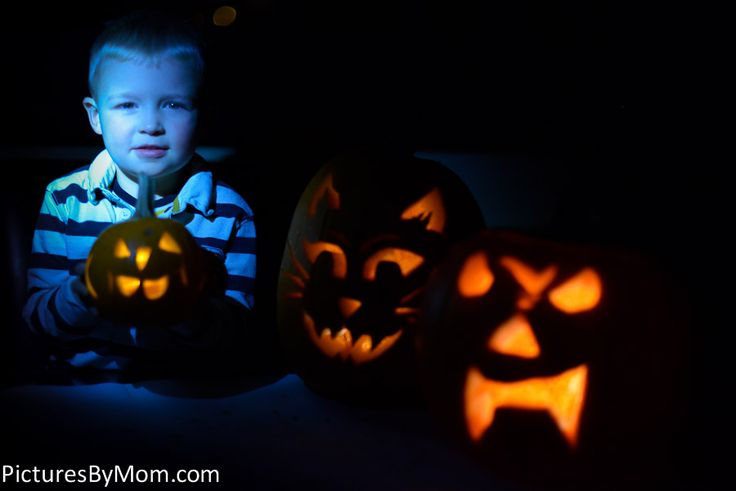 Spooky blue little boy with his Halloween jack-o-lanterns.  How to take pumpkin carving pictures in your kitchen or dining room.  http://www.picturesbymom.com/