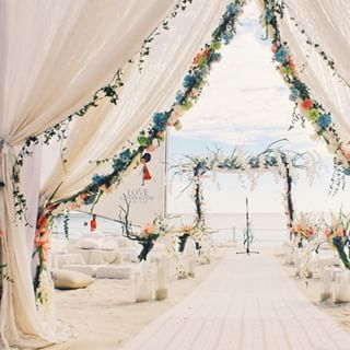 Nothing like walking down this ethereal aisle.   This Couple (And Their Guests) Renewed Their Vows At The Beach Wedding Of Your Dreams