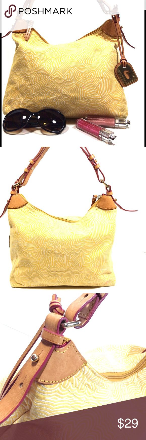 Dooney and Bourke Yellow Canvas Shoulder Bag Adorable colorful bag. White design on yellow canvas back drop. Bag has been used and as such has spots were its slightly soiled. Has a nice patina on the leather. Eye catching hot pink interior with loads of storage space. Corners show wear in the form of being slightly dirty. Also has some pink spots on the outside of the bag (see pic). Still a beautiful bag with tons of potential. Size 13 1/2'' x 9 1/2'' with a strap drop of 9 1/2'' Dooney…