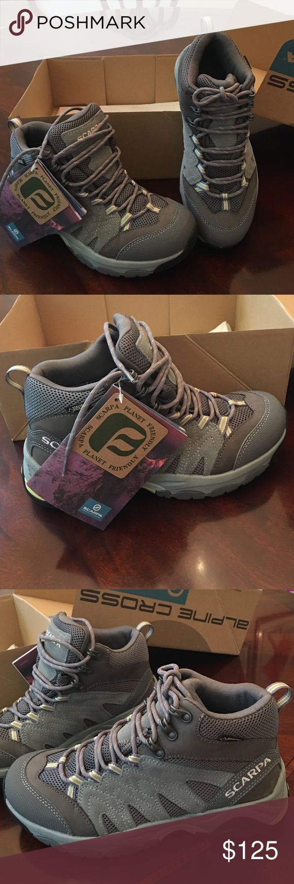 Scarpa NIB lady's hiking boots Brand new boots from Italian brand Scarpa. I accidentally ordered the wrong size. My looks is your gain!  GORE-TEX keeps your feet 100% dry on those rainy hikes. Suede & man-made outers. Smoke-free home. No trades or holds. Scarpa Shoes Lace Up Boots