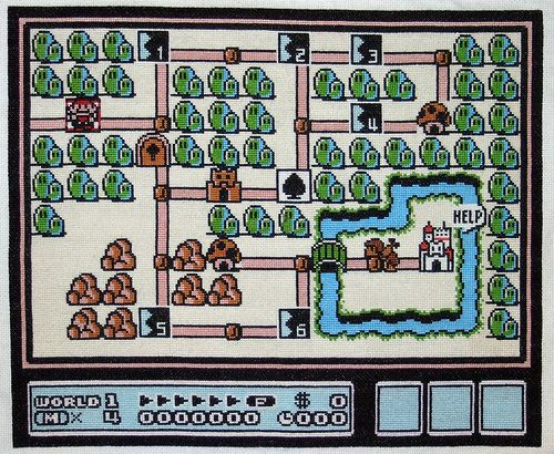 A cross stitch of an entire map from Super Mario Bros 3