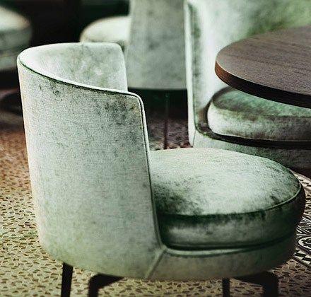 Green velvet chairs by Flexform in The Jane restaurant, Antwerp, Belgium, designed by Piet Boon