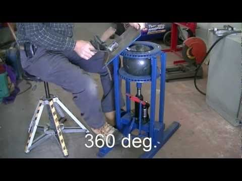 welding work table using bowling ball, disc brake, bottle jack. Very cool.