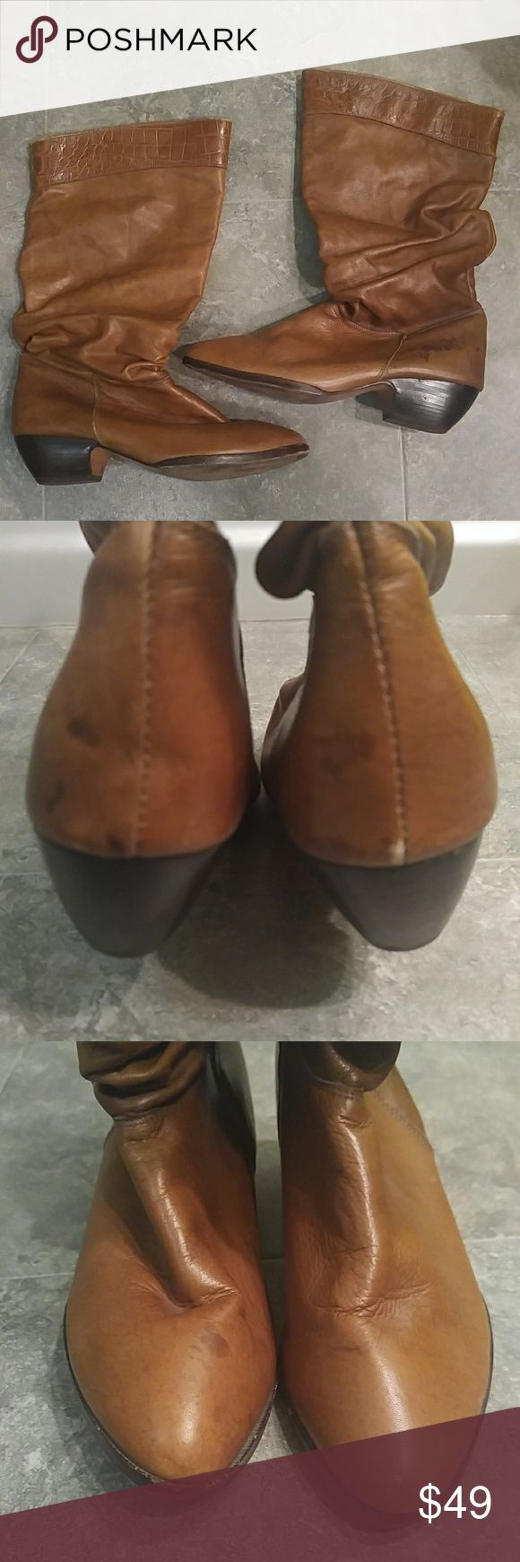 Vintage Genuine Leather Cognac Knee Boots Made in U.S.A. Size says 7 but fits like women's narrow 6-6.5. Small water stain at upper right toe & back left heel. Other than that, these are in excellent used vintage condition. *From smoke/fragrance/pet free home. No Trades/modeling* Vintage Shoes Heeled Boots