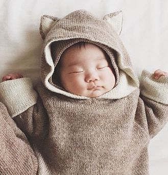 Inspired by Maurice Sendak's infamous tale, Waddler's hand knitted baby alpaca wool jumpers have reversible hoods with different ears on each side, meaning one can magically transition from wolf to bear depending on what the situation requires.