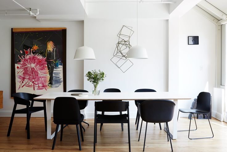 A series of black Muuto chairs—Fiber, Cover, Nerd, and Visu—surrounds a 70/70…