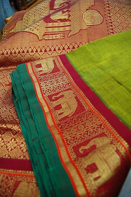 Elephant border in gold thread on a silk sari.