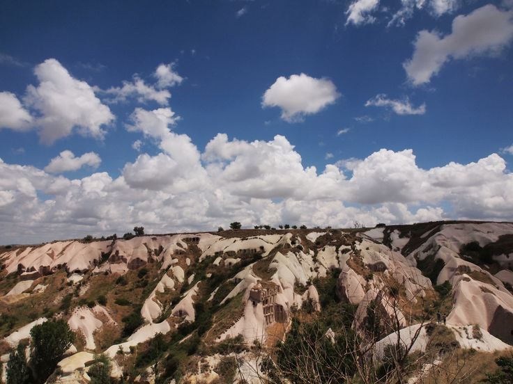 June 2013 - Pigeon Valley at Cappadocia Turkey. Had lunch with a sight, pretty sky with fluffy clouds and amazing landscape. Awesome!!
