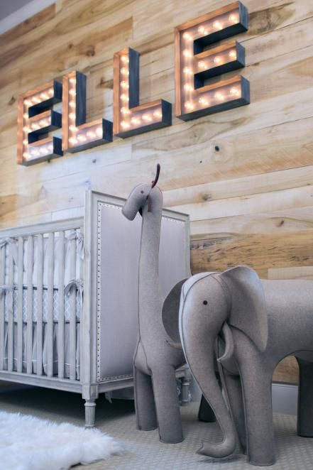 HGTV presents a transitional nursery that borders on the eclectic with its rustic wall, marquee letters and animal-themed decor.