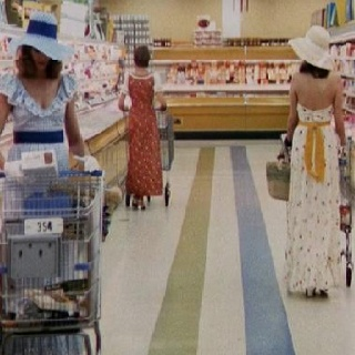 "Grocery Shopping in the 70's. Notice how they are all dressed properly and neatly. Actually this is a still shot from the original ""Stepford Wives"" movie"