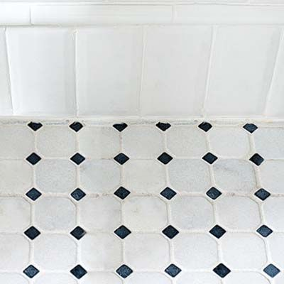 creative use of subway tile makes a baseboard for this classic twenties  style remodeled bath. 8 best Prewar Renovation Bathroom ideas images on Pinterest