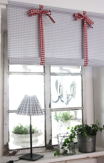 Gray gingham window shade with red gingham ties :)