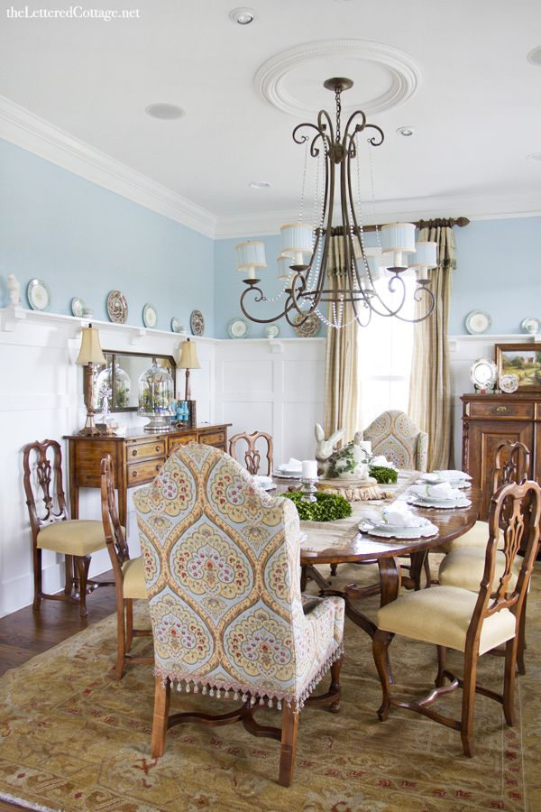 A fantastic dining room with the tall white panels and lots of pale turquoise painted walls...